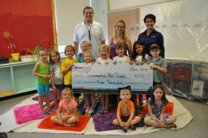 Bruce Power donated $5,000 to the Southampton Art School for its summer program. Susan Seitz, middle, Art Instructor at the school, and some of her enthusiastic young artists received the donation from Drew Henkel and Christine John, of Bruce Power's Community Relations department.